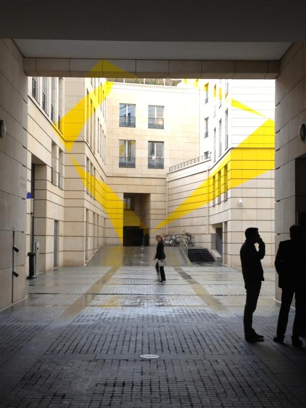 Yellow splash rainy Paris street