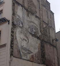 paris woman street art facade