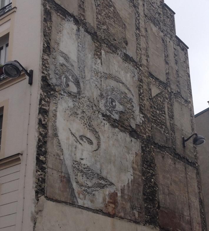 paris woman street art facade